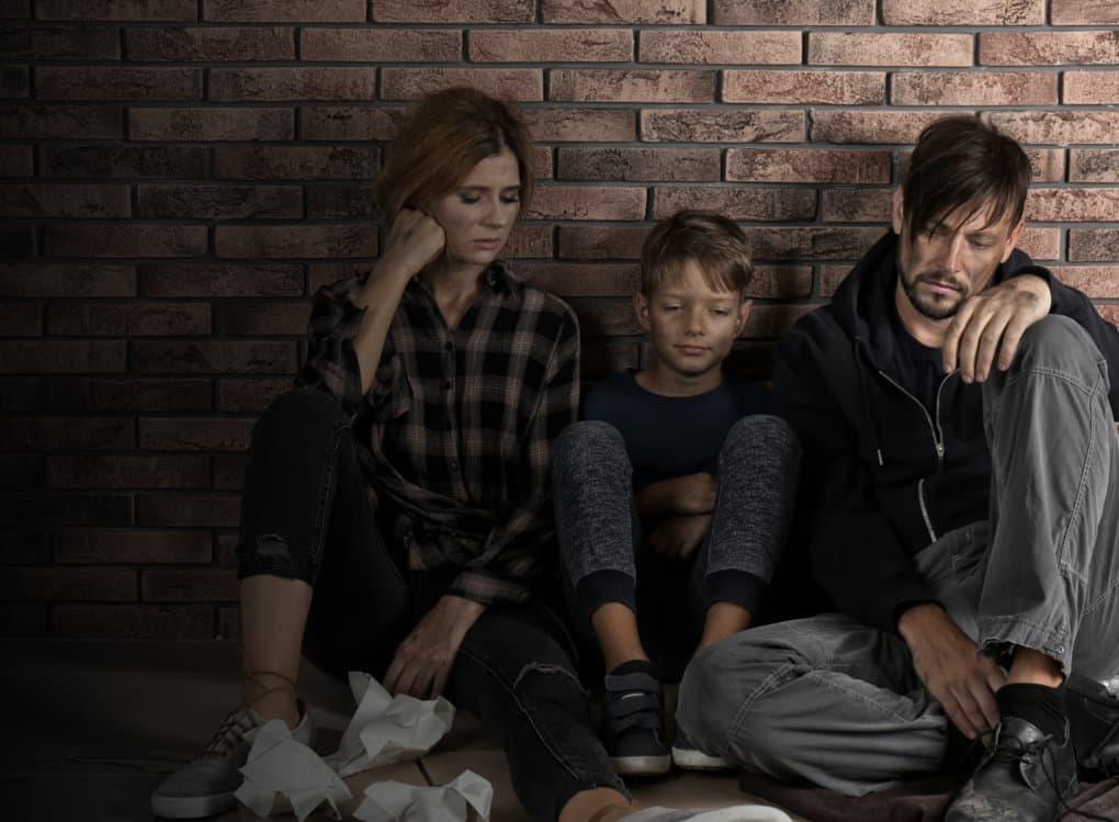 sad homeless family