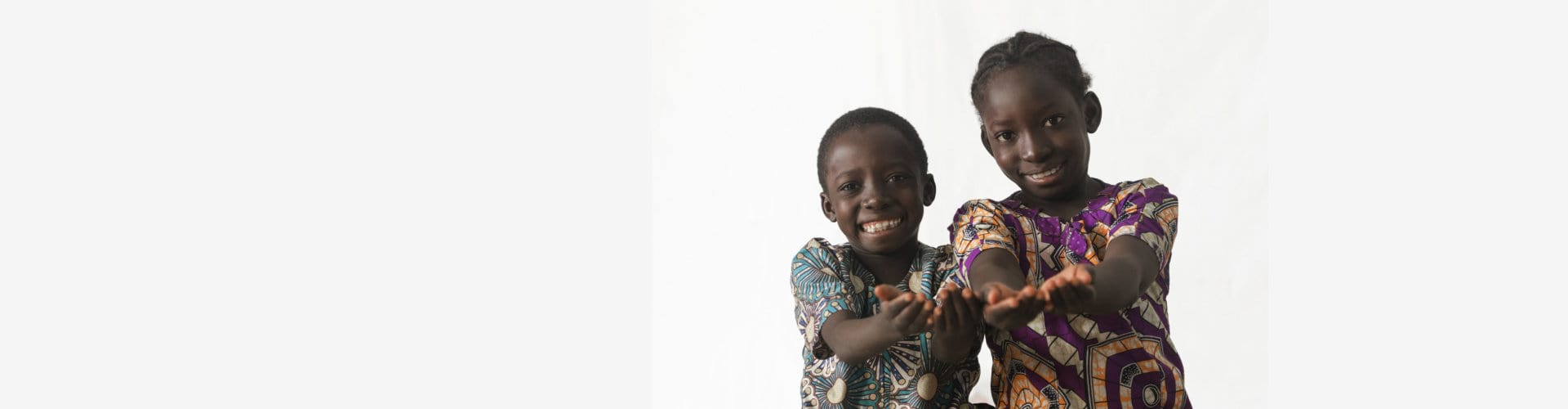two children showing their palms asking for donation